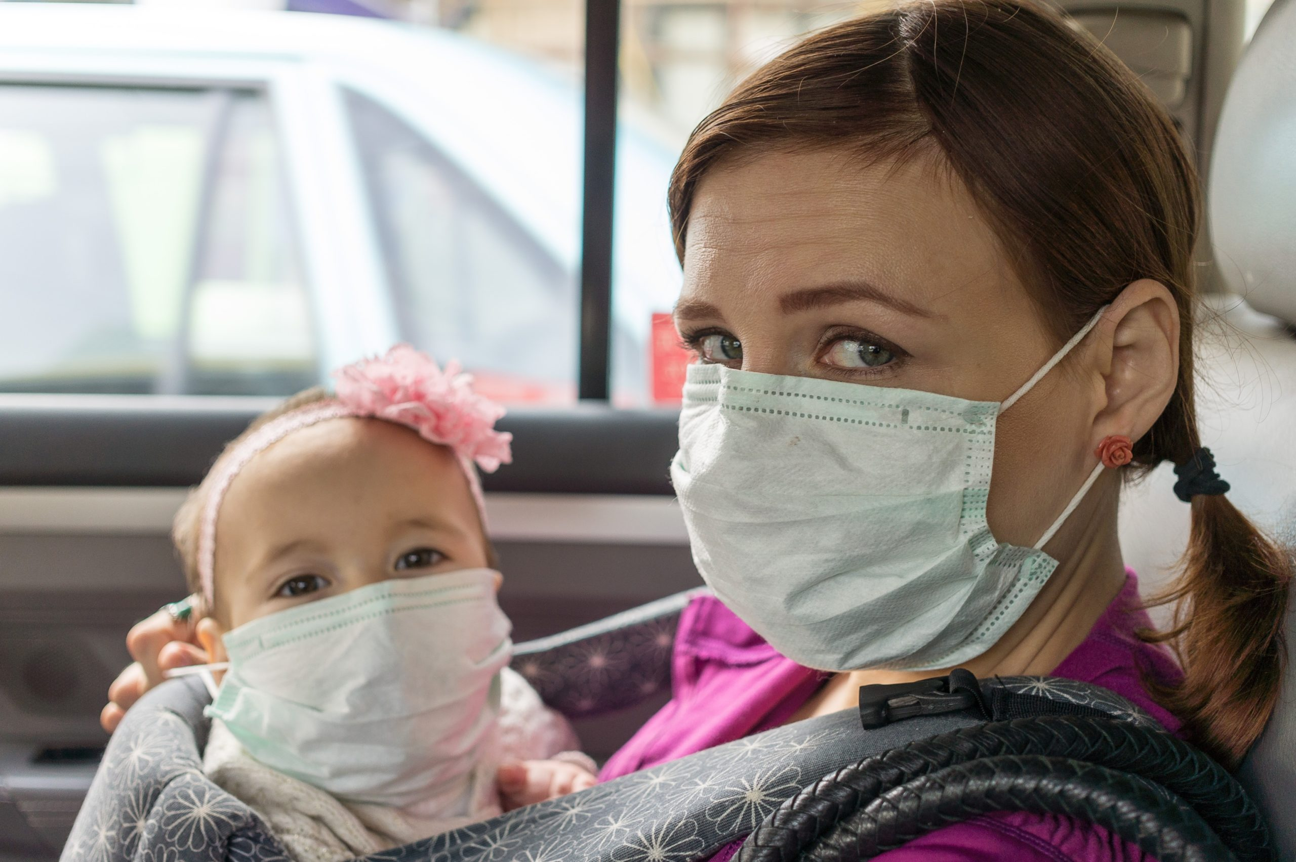 Mother and baby wearing protective masks